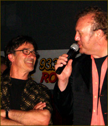 WNCD's Cornell Bogdan and King Cool share a warm moment, probably about cigars and their current golf handicaps.